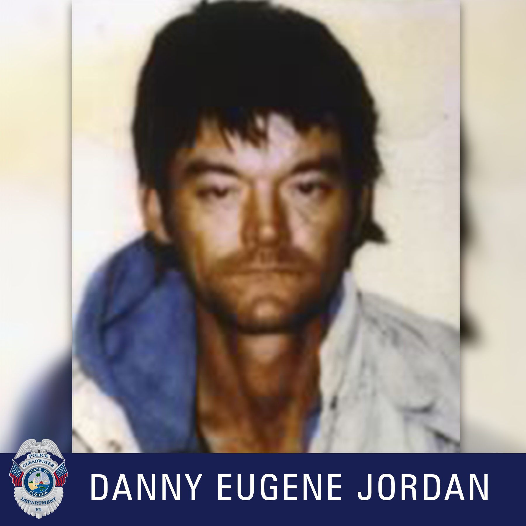 Danny Eugene Jordan, Clearwater Police Department shield, Male with black hair wearing a faded jean shirt