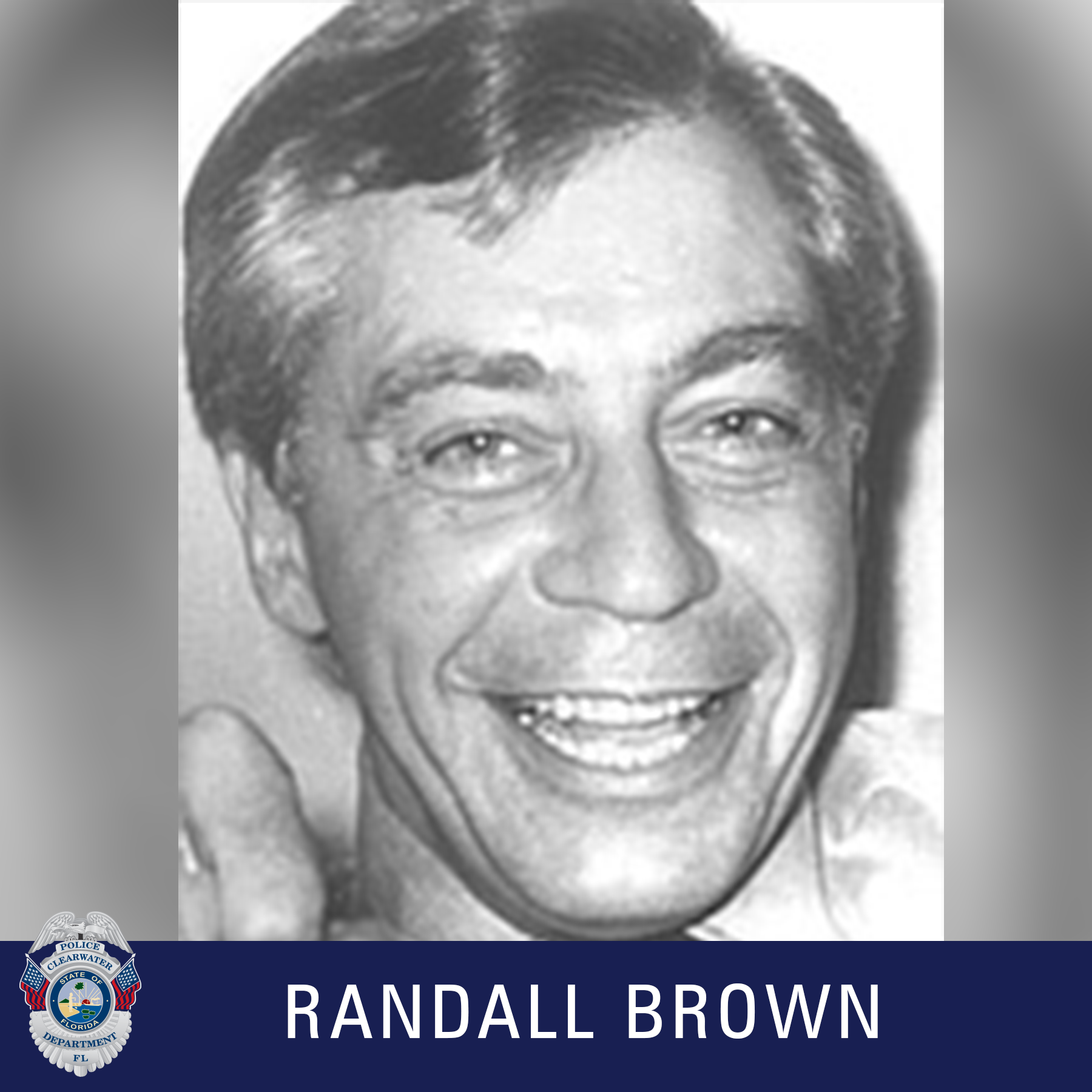 Randall Brown, Clearwater Police Department Shield, Black and white photo of a male smiling