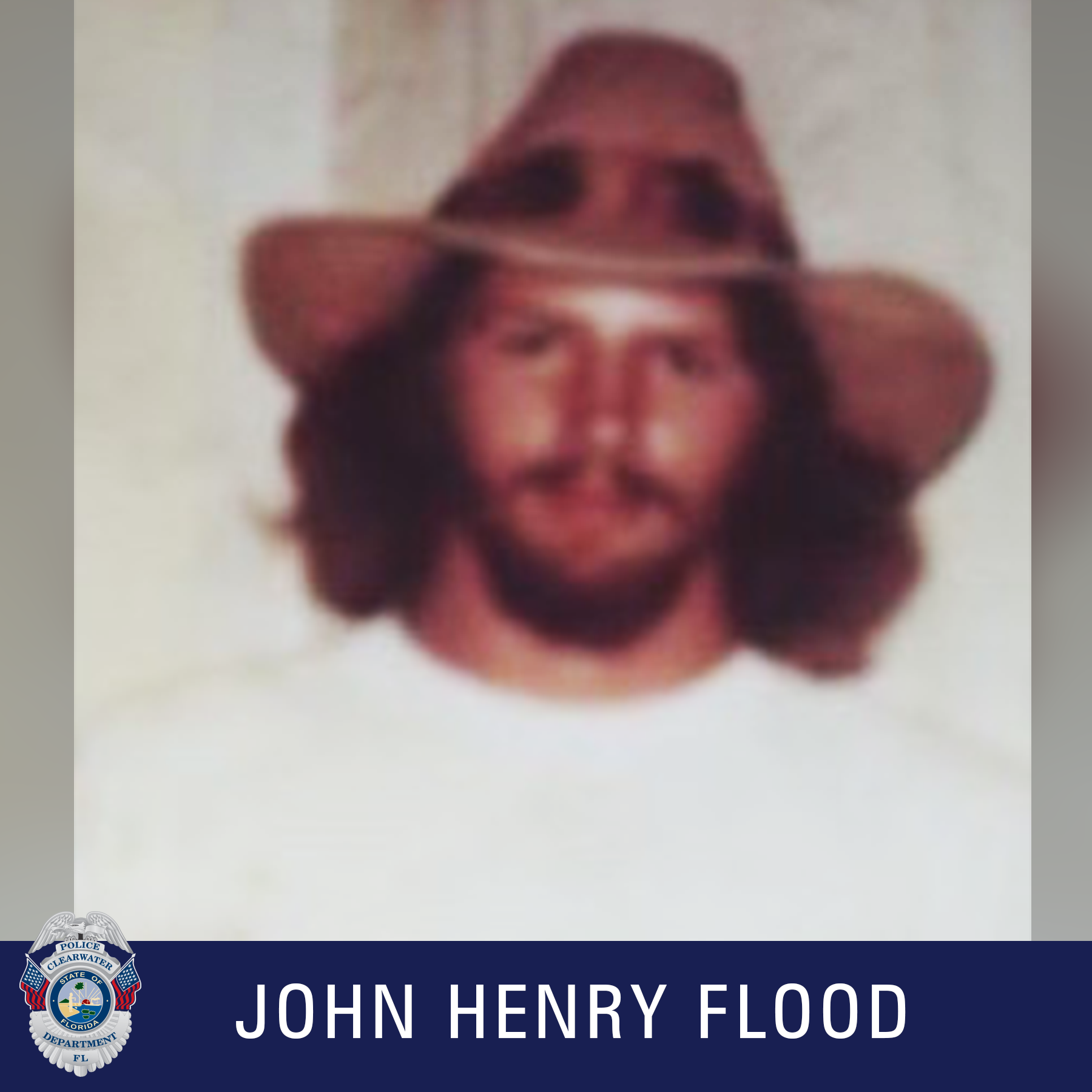 John Henry Flood, Clearwater Police Department Shield, Male with brown long hair and brown beard and mustache wearing a hat