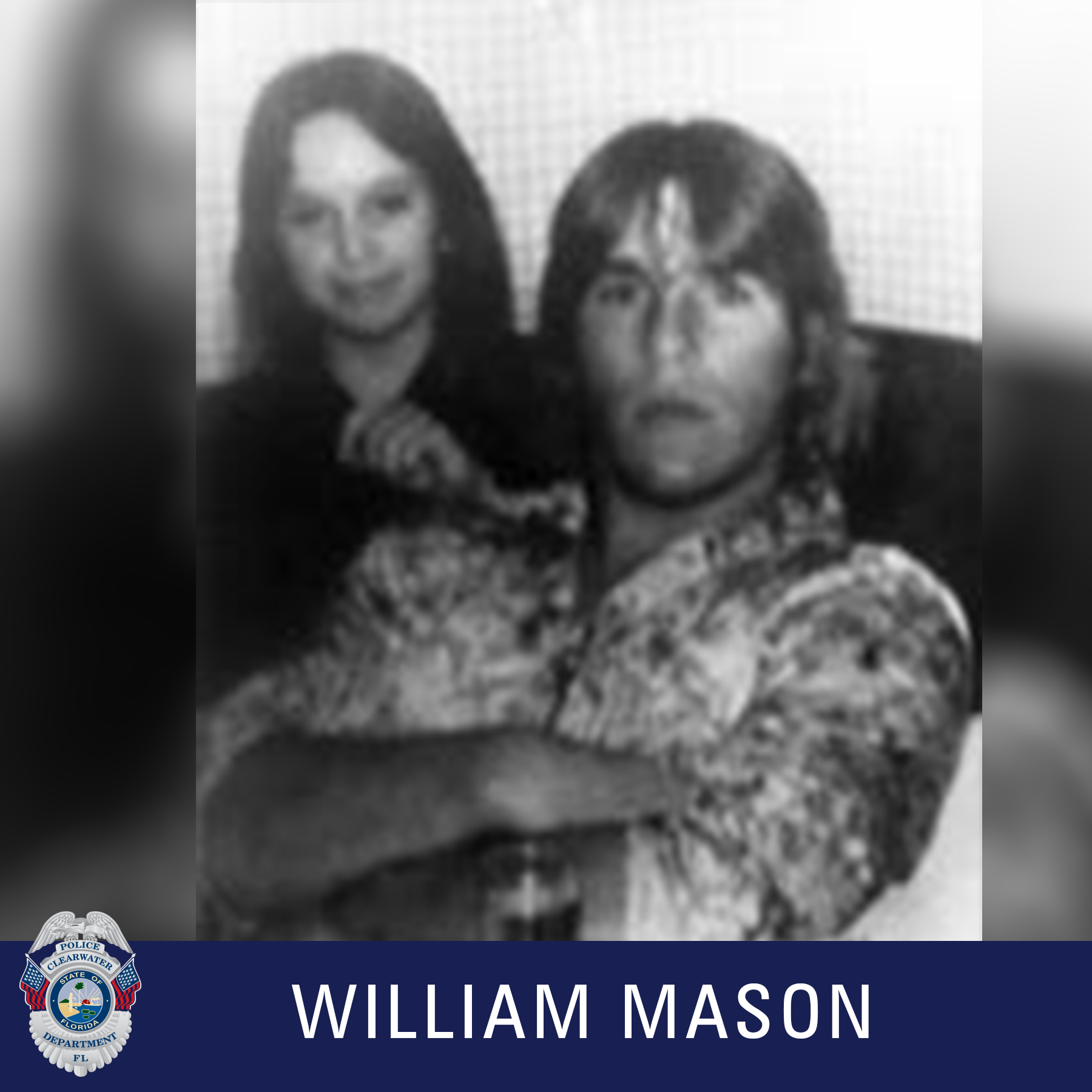 William Mason, Clearwater Police Department Shield, Black and white photo of a male crossing his arm with long hair while a female stands behind him