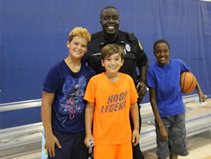 Officer with boys and a basketball